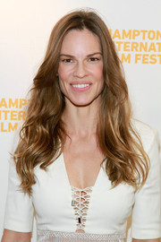 Hilary Swank wore her long hair loose with pretty waves during the Hamptons International Film Festival.