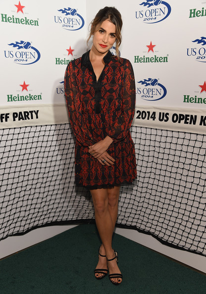 Nikki Reed chose a pair of elegant black strappy sandals to complete her look.