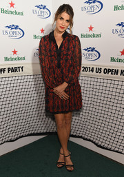 Nikki Reed donned a modest yet cute red and black shirtdress by Alice + Olivia for the Heineken US Open kick-off party.