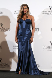 Laverne Cox went for modern glamour at the International Emmy Awards in a blue Johanna Johnson strapless gown featuring geometric panels and a flowing train.