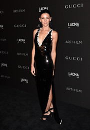Liberty Ross sparkled in a black paillette gown with a plunging neckline and a high slit during the LACMA Art + Film Gala.