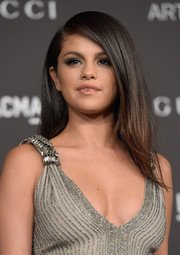 Selena Gomez wore her hair with a deep side part and a subtle flip at the ends during the LACMA Art + Film Gala.