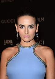 Camilla Belle opted for pale-pink lipstick to finish off her beauty look.