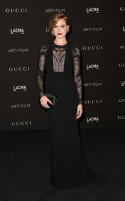 Evan Rachel Wood completed her elegant all-black look with a Gucci satin clutch.