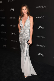 Cindy Crawford showed off her still-gorgeous supermodel physique in a deep-V, beaded Roberto Cavalli gown during the LACMA Art + Film Gala.