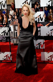Rita Ora flaunted major cleavage in a black Barbara Casasola gown with a deep plunge during the MTV Movie Awards.