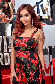 Wearing a sleeveless dress to the MTV Movie Awards, Nicole Polizzi showed off her star and crown tattoo.