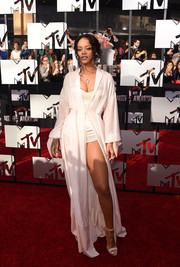 Rihanna looked super seductive at the MTV Movie Awards in this white robe-like gown and bodysuit combo by Ulyana Sergeenko Couture.