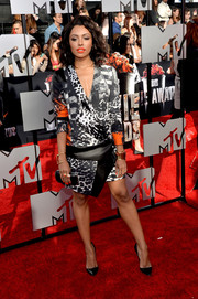 Kat Graham looked ultra modern at the MTV Movie Awards in a Roberto Cavalli mixed-print dress with a faux-wrap bodice and an asymmetrical skirt.
