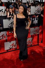 Nicki Minaj looked uncharacteristically understated at the MTV Movie Awards in a black Alexander McQueen gown that played up her curves perfectly.