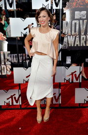 Karina Smirnoff chose a drapey white skirt to pair with her crop-top.