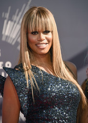 Laverne Cox wore her hair straight with eye-grazing bangs.