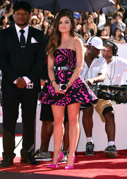 Lucy Hale wore her pink and black patterned Oscar de la Renta mini dress with pink Brian Atwood heels.
