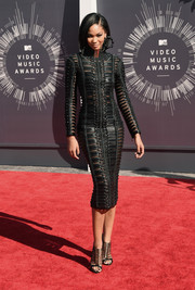 "Chanel Iman looked perfectly edgy in a black Balmain dress paired with Casadei's black leather ""Cage"" sandal."