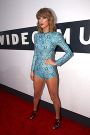 Taylor Swift rocked a long-sleeve blue bodysuit by Mary Katrantzou on the MTV VMAs red carpet.