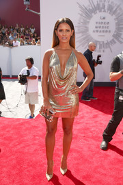 Rocsi Diaz worked the MTV VMAs red carpet in a sultry gold mini dress with a deep cowl neck.