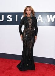 Beyonce Knowles was sexy-goth at the MTV VMAs in a beaded black Nicolas Jebran gown with see-through mesh panels.