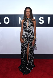 Singer Michelle Williams looked fierce in a Roberto Cavalli giraffe-print halter gown featuring a sexy key-hole neckline.