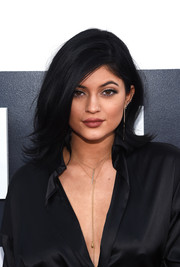 Kylie Jenner attended the MTV VMAs wearing a super-sexy version of the flip hairstyle.