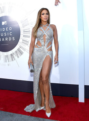 Going for all-out shimmer, Jennifer Lopez teamed her daring dress with silver Jimmy Choo Tartini pumps.