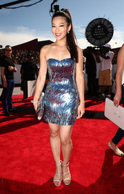Arden Cho wore a sparkling minidress with ALDO Margetts sandals in silver.