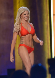 Theresa Vail showed off her stunningly sexy physique (and her massive tattoo) in an orange halter bikini during the 2014 Miss America competition.