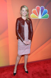 Katherine Heigl teamed an oxblood leather jacket with a tweed dress for the NBC Upfront Presentation.