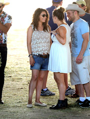 Mila Kunis teamed her top with denim shorts.