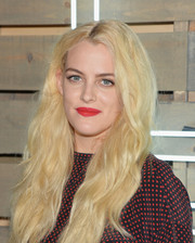 Riley Keough's bold red lipstick looked striking against her pale skin and hair.