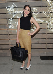 Audrey Gelman styled her top with a beige tweed pencil skirt.