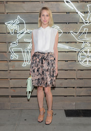 Indre Rockefeller finished off her outfit in edgy style with a pair of peach cutout boots.