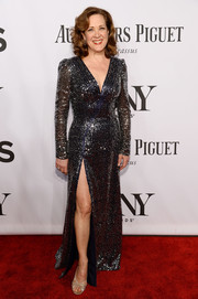 Karen Ziemba went for high sparkle at the Tony Awards in a sequined black gown with a deep-V neckline and a thigh-high slit.