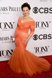 Fran Drescher sported a very curvy silhouette in a coral off-the-shoulder mermaid gown during the Tony Awards.