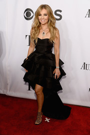 Thalia got all dolled up in a tiered black fishtail dress for the Tony Awards.