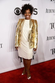 Gladys Knight continued the gold-white motif with a pair of embellished cap-toe pumps.