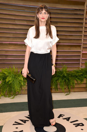 Amanda Peet teamed her blouse with a long black skirt, also by Band of Outsiders, for a more elegant finish.