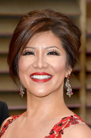 Julie Chen attended the Vanity Fair Oscar party wearing her hair in an elegant beehive.