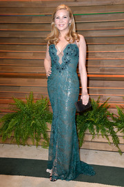 Jennifer Westfeldt donned a slinky teal lace gown with a nude overlay for the Vanity Fair Oscar party.