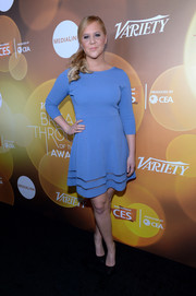 Amy Schumer donned a minimalist-chic blue cocktail dress for the Variety Breakthrough Awards.