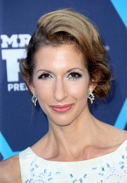 Alysia Reiner dolled up her look with a pair of multicolored gemstone earrings.