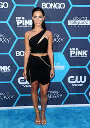 Jessica Lowndes amped up the sex appeal with a zipper-detailed black mini skirt, also by Three Floor.