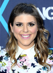 Molly Tarlov wore a cute half-up wavy hairstyle at the Young Hollywood Awards.