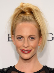 Poppy Delevingne went the punk route with this messy high ponytail during the amfAR New York Gala.