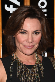 LuAnn de Lesseps looked stylish with her flippy bob at the 2014 amfAR generationCURE Holiday Party.