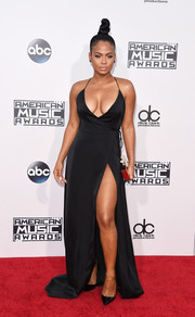 Christina Milian ravished on the American Music Awards red carpet in a plunging black wrap gown.