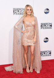 Carrie Underwood looked diva-ish at the American Music Awards in a Yas Couture beaded mini dress with a floor-sweeping cape.