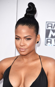 Christina Milian rocked a towering top knot at the American Music Awards.