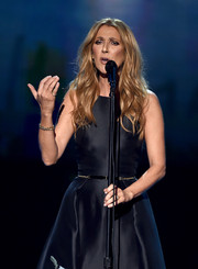Celine Dion accessorized with a gold link bracelet for her performance at the 2015 American Music Awards.
