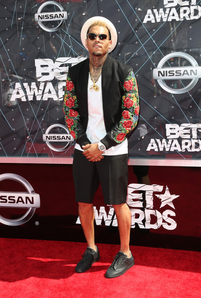 Chris Brown hit the red carpet wearing a customized varsity jacket with floral sleeves.