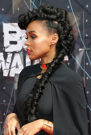 Janelle Monae caught eyes with her BET Awards hairstyle, an elaborate fauxhawk that flowed down into a fishtail braid.